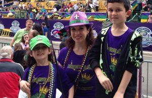 family wearing matching clothes at mardi gras.jpg