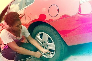 girl changes tire