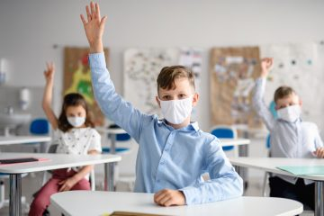 School children masked and socially distanced in the classroom